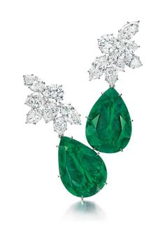 Christies NY- A PAIR OF DIAMOND AND EMERALD EAR PENDANTS Estimated at $800,000.Each suspending a detachable pear-shaped emerald, weighing approximately 24.48 & 21.60 carats, to the circular, pear and marquise-cut diamond cluster surmount, mounted in platinum, surmounts 1961,Surmounts signed H.W. for Harry Winston, no. 31881.   Gemological testing revealed characteristics consistent with those of emeralds originating from Colombia.