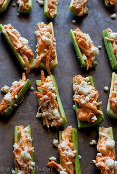 Buffalo Chicken & Celery Appetizers are the easiest way to enjoy spicy buffalo chicken. Healthy buffalo chicken dip is great for football Sunday, but these bite sized appetizers are great all year long.