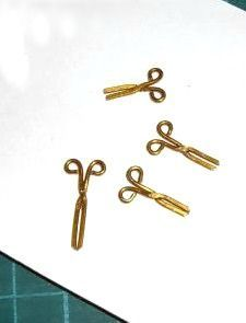 how to: mini scissors... Made with eye pins.