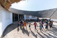 The school was constructed from materials found near the site. Its walls are made from compressed-mud bricks from earth found on-site and the bamboo beams and thatch for the roof were grown nearby.