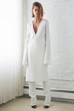 chapron v neck tunic dress with cone sleeve . whitman boot leg tux pant