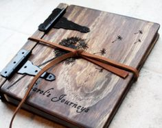 Custom handmade wooden wedding album/ photo album with Monogram or personalized engraving  This handmade wooden wedding album is crafted to order from hand cut, sanded, and stained wooden sheets. Each piece of wood is carefully and artistically stained using a layering technique to give it a unique dark rustic look. Genuine cowhide leather is rubbed with mink oil to bring out a nice leathery smell and is formed into the spine of the book. Once the book cover has been made, your names and...