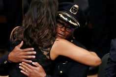 U.S. First Lady Michelle Obama hugs Dallas police chief David Brown at a memorial service following the multiple police shootings in Dallas, Texas, U.S., July 12, 2016.  REUTERS/Carlo Allegri via @AOL_Lifestyle Read more: http://www.aol.com/article/2016/07/13/george-w-bush-turns-heads-at-dallas-funeral-with-dance-moves/21431217/?a_dgi=aolshare_pinterest#fullscreen