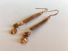 Hand hammered copper drop earrings have tiny crystal and copper dangles at the end. Their length is 2 1/2 from the top of the copper french wires. Your satisfaction is guaranteed. ♥ Buy Unique. Buy Quality.♥ Buy TuscanRoad. Enjoy, and thanks for looking! To See More of My Fashion Earrings: http://etsy.me/oBFqNp * WANT TO RECEIVE EXCLUSIVE OFFERS & BE INFORMED OF PRIVATE SALES? Sign up by pasting this link into your browser: http://eepurl.com/buv1Sv