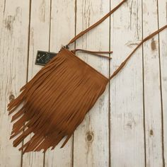 """Fringe Crossbody This is a beautiful cognac messenger style  bag. Brand new, never been worn. Measures 10.1""""x8.1"""" Bags Crossbody Bags"""