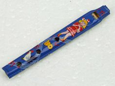 Vintage Carnival Tin Toy Penny Whistle Pennywhistle Made in Japan Blue Background with Colorful Graphics NOS ACTTEAM by VirtuallyVintageCT on Etsy https://www.etsy.com/listing/467771694/vintage-carnival-tin-toy-penny-whistle