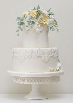 Rosalind Miller Cakes white vintage lace with sage and yellow bouquet of flowers wedding cake