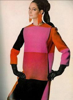 Donna Allegra Caracciolo di Castagneto is wearing a wool coat in sizzling colors that fastens on the side by Forquet. Photo by Irving Penn, 1966.