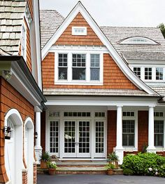 We love the contrast of warm stained wood and sleek white trim on this cottage-style home. See more of our favorite exterior color schemes: http://www.bhg.com/home-improvement/exteriors/curb-appeal/best-exterior-house-color-schemes/?socsrc=bhgpin040813stainedshingles=9