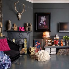 eclectic bohemian. love the charcoal walls, flooring, and antlers
