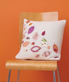Decorate a pretty pillow using both traditional and reverse applique techniques. Free template!