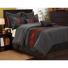 Give your room a new look with this 7-piece Corell red and black comforter set. Including everything you need in a bed set, the classic black bed skirt features a 15-inch drop to the floor so it can easily hide things stored underneath the bed.