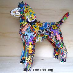 Big dog sculpture made from toys...
