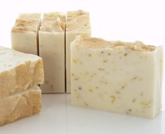 Gold & Frankincense by Blossom & Twig Artisan Soap.  This super-mild soap has calendula flower-infused oil and lovely golden calendula petals throughout for gentle exfoliation. Scented with a heady essential oil blend of frankincense, bergamot, and lavender, and dusted with shiny gold mica.