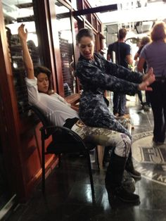 Hawaii 5-0 actresses Grace Park and Michelle Borth larking around on-set