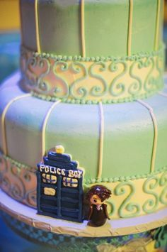 My Doctor Who wedding cake with The 10th Doctor (David Tennant) and TARDIS. My groom is gluten free/dairy free and couldn't eat the cake, so I had this added as a surprise for him. Melanie Parker & Bryan Alaspa wedding on 11/10/12. Vendors: Sweet Dream Bakery and Two Birds Photography.