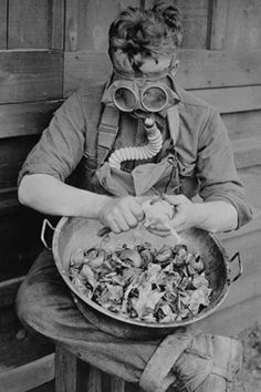 World War 1 American Soldier Peeling Onions in Gas Mask vintage print