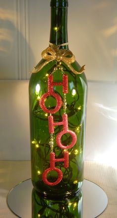Christmas Decoration Wine Bottle Lamp with HO HO HO. $26.00, via Etsy.