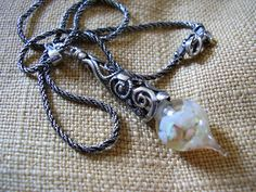 Floating opals necklace using vintage sterling silver chain and pendant cap.