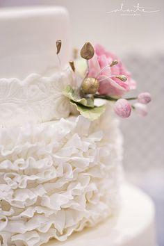 The SweetSide's white on white ruffled wedding cake  Photo: Alante Photography