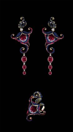 Jewellery Theatres yellow gold Flowers earrings and ring features white, green and blue diamonds, rubies and sapphires.