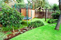 Children's play area with playframe, astroturf and bespoke western red cedar cupboard