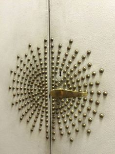 Vintage doors with nailhead hardware designed by Jean Royere