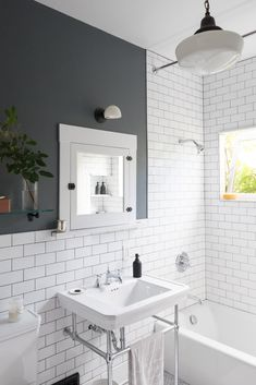 Before & After: A DIY Couple Tackle Their 1915 Craftsman in San Diego - Photo 19 of 20 - White subway tiles and dark grout give the new bathroom a crisp, clean look. Vintage Bathroom Lighting, Modern Bathroom, Small Bathroom, Colorful Bathroom, Vintage Bathroom Tiles, 1930s Bathroom, Small White Bathrooms, Bathroom Pendant Lighting, Bathroom Wall Lights