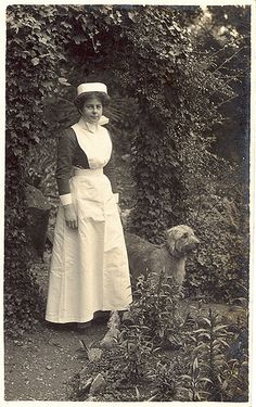 WWI British nurse with a dog in the garden