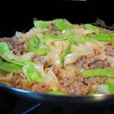 One Perfect Bite: Cantonese Fried Noodles   8 ounces wide rice stick noodles (bahn pho, XL) 2 tablespoons soy sauce, divided use 1 tablespoon rice wine 3-1/2 teaspoons cornstarch, divided use 1 teaspoon granulated sugar, divided use 8 ounces tender steak (i.e. sirloin or flatiron), thinly sliced 3 tablespoons oyster sauce 2 teaspoons dark sesame oil 3/4 cup reduced sodium chicken broth 8 ounces snow peas, trimmed and blanched 2 tablespoons vegetable oil, divided use
