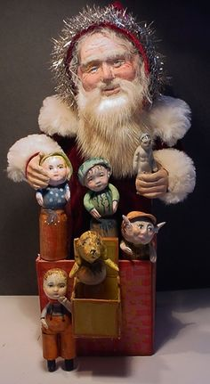 Yes, you truly are a gift giver. (A Santa Jack in the box, loaded with hand made toys and he is dressed in fur and antique red velvet.  decamp)