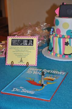 A kids favorite book makes a great place for guests to sign or send messages at a 1st birthday party.  See more first girl birthday party ideas at www.one-stop-party-ideas.com