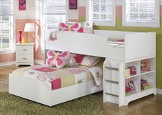 "Lulu Twin/Twin Loft Bed w/ Caster Bed The light airy cottage design of the ""Lulu"" youth bedroom collection features a replicated white paint finish flowing beautifully over the grooved panels and embossed bead framing to make this innovative furniture an inviting addition to any child's bedroom."