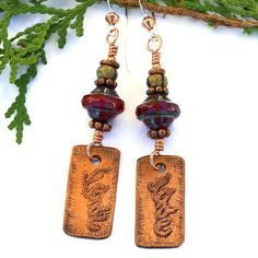 The Love earrings feature artisan handmade etched copper love rectangles, ruby red Czech glass Saturn beads, rustic Czech glass rondelles, copper and sterling silver - Valentines jewelry for women.