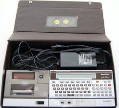 Sharp PC-1500A Pocket Computer, Printer CE-150, and Case.
