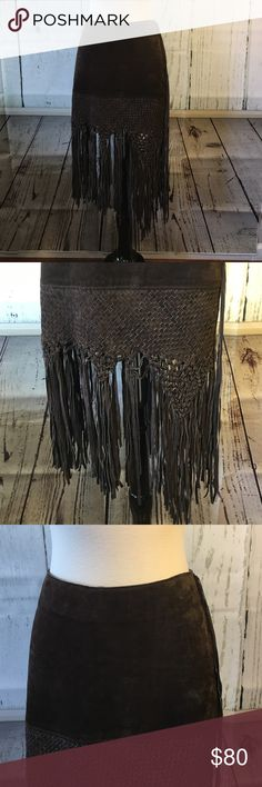 SALE 🎀Bebe Boho Brown Leather Fringed Skirt🎀 This is a gorgeous brown suede with brown leather fringe all around the bottom half of the skirt and there's one long 4 strand fringe tassel that hangs on the left side from the top of the waist to the bottom of the skirt. I've never seen a more beautiful skirt! bebe Skirts
