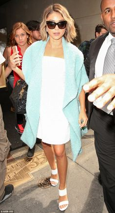 Immaculate: Actress Sarah Hyland, 24, came up trumps in a simple strapless white mini-dress and matching heeled mules as she arrived at the Today Show in New York on Tuesday
