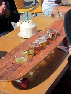 """At the Venice Ale House, their sampler of drinks is served on a modified longboard and is called a """"skate."""""""