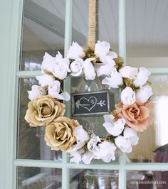 This country-chic wreath gets an updated twist with gilded roses and an adorable chalkboard doodle detail. Get the tutorial at Up To Date Interiors » - GoodHousekeeping.com