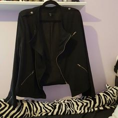 NWOT Light cute zipper jacket Never worn. Super cute. Sized as a 2 but I don't see how. It fits like an XL.  No noticable wear and tear. If you find any after purchase please notify me by email. My email is cassidys.closet.poshmark@gmail.com and we can work it out :) Offers welcome! Thanks!? Jackets & Coats