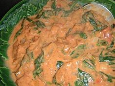 Mchicha - Tanzanian Spinach & Peanut Curry. from Food.com:   								Mchicha is a very traditional dish in Tanzania & can be made like this with peanut butter - homemade or natural is best - or it can be made with a whole coconut (grated flesh & milk) instead. Posted for ZWT 4.
