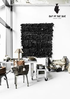 love the rug on the wall (and the table as well) | Out of the Blue Concept Store Eindhoven Strijp-S