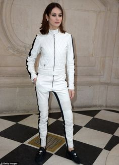 Lady in leather: Olga Kurylenko, another to attend the Schiaparelli Fashion show, made her...