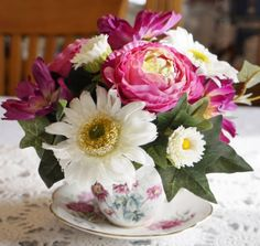 A tiny flower arrangement in a teacup or a mug brightens your day. Check out these examples and the tips for creating miniature arrangements.