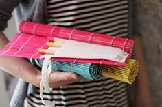 Placemat paintbrush roll-up holder--make a smaller amount of holders and you have a mat for painting, too :)