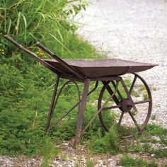 Distressed decorative wheelbarrow.  Product: WheelbarrowConstruction Material: MetalColor: Rust