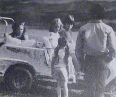 Lisa, 7, in her powder blue golf cart her daddy (at right) gave her at Graceland