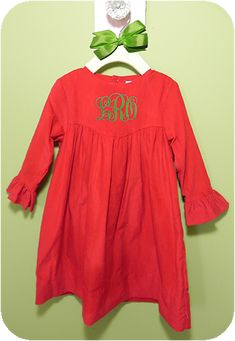 Red Corduroy Bishop Dress   The bishop style girls dress is an all time classic favorite. We love the added detail of the bell sleeves.  Too cute! We picture it with some fun striped tights.  Perfect for family portraits and Christmas parties.
