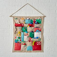 Shop Toy Advent Calendar. Nothing says Christmas like this colorful modern kids advent calendar. It's filled with vibrant holiday hues and patterns.