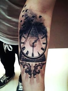 A meaningful tattoo of a clock on a pyramid and with black birds atop. Style: Black and Gray. Color: Black. Tags: Meaningful